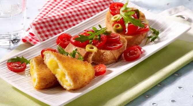 Valess Valess Gouda mit Bruschetta und Tomaten-Oliven-Rauke-Topping